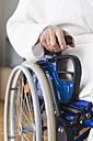 Germany, Leipzig, Senior woman sitting on wheelchair - WESTF018833