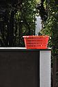 Germany, Bavaria, Empty hamper on wall - AXF000110