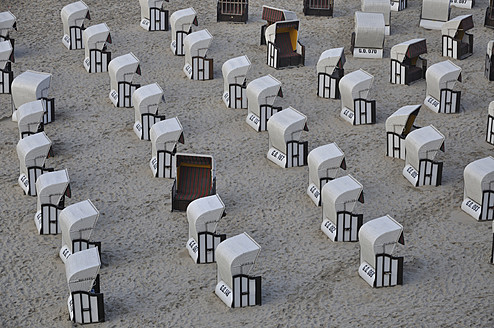 Germany, Ruegen, Sellin, Hooded beach chairs on beach - AXF000126