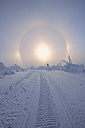Germany, Saxony, View of sundog with snowy landscape - RUEF000890