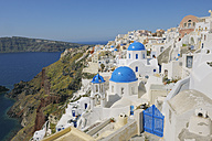 Greece, Santorini, View of classical whitewashed church and bell tower at Oia - RUEF000971