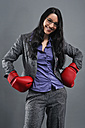 Young woman wearing boxing gloves, portrait, close up - RDF001021