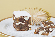 Slices of panforte with straw star on paper plate - GWF001877