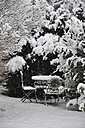 Germany, Bavaria, View of snow covered table and chair - AXF000158