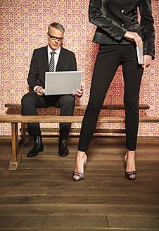 Germany, Stuttgart, Business couple using laptop - MFP000156