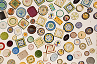 Portugal, Variety of plates hanging on wall at pottery - UMF000384