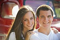 USA, Texas, Teenage boy and girl smiling, portrait - ABAF000146