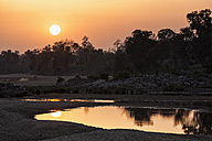 India, Madhya Pradesh, Sunset over river Banjar at Kanha National Park - FOF004242