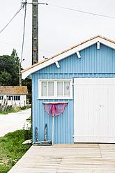 France, Light blue fisher hut at Atlantic coast - MS002722