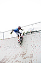 France, Boy skateboarding on sports ramp - MSF002735