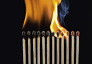 Burning matchsticks against black background, close up - WBF001359