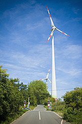 Germany, Saxony, View of wind turbine in wind park - MJ000073