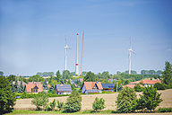 Germany, Saxony, View of wind turbine with solar panel in wind park - MJ000081