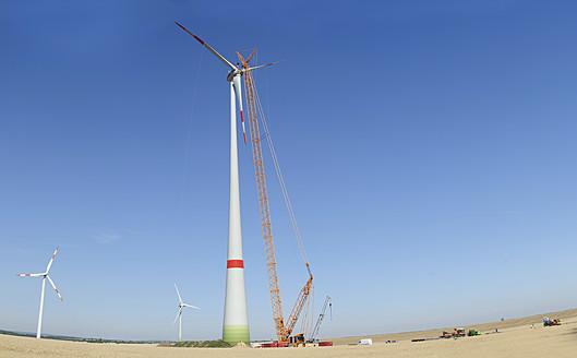 Germany, Saxony, Cnstruction of wind turbine with crane - MJ000077