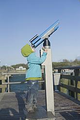 Germany,  Mecklenburg Western Pomerania, Boy looking through telescope - MJF000119