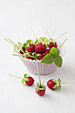 Paper cup of wild strawberries, close up - ECF000080