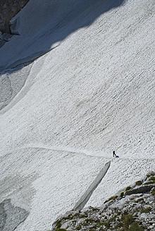 Germany, Bavaria, Man climbing mountain - KAF000025