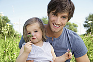 Germany, Cologne, Father and daughter smiling, portrait - PDYF000017