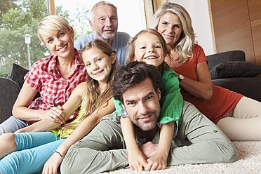 Germany, Bavaria, Nuremberg, Portrait of family in living room - RBYF000147