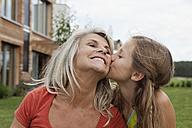 Germany, Bavaria, Nuremberg, Granddaughter kissing grandmother - RBYF000178