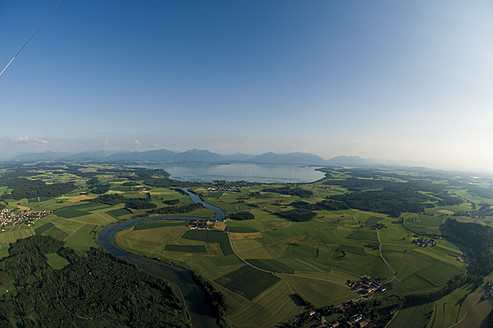 Germany, Bavaria, View of pasture landscape and Lake Chiemsee - GNF001240