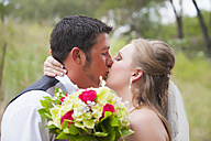 USA, Texas, Bride and groom kissing on wedding day - ABAF000263