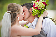 USA, Texas, Bride and groom kissing on wedding day - ABAF000259