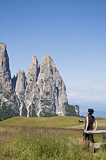 Italy, Mid adult woman looking at Schlern  at South Tyrol - UMF000440