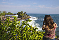 Indonesia, Bali, Tourist at Tanah Lot Temple - MBEF000491