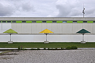 Germany, Bavaria, Three sunshades in front of modern building - AXF000249
