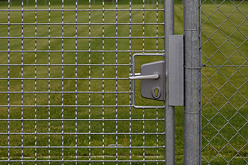 Germany, Bavaria, Door with wire mesh fence - AXF000264
