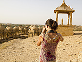 India, Rajasthan, Jaisalmer, Tourist at Bada Bagh Cenotaphs - MBEF000486