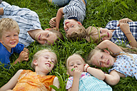 Germany, Bavaria, Group of children lying in meadow - HSIYF000055