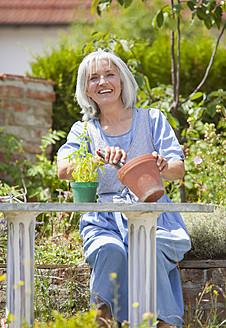 Germany, Bavaria, Mature woman gardening, smiling - HSIYF000123