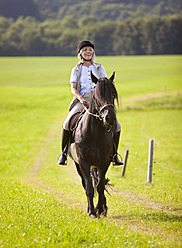 Germany, Bavaria, Mature woman riding horse - HSIYF000098