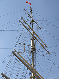 Germany, Hamburg, Rigging on old sailing ship with flag - BSCF000154