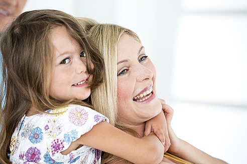 Germany, Mother and daughter smiling, close-up - RFF000007
