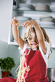 Germany, Girl playing with spaghetti - RFF000061