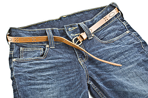 Blue jeans with leather belt on white background - MAEF005011