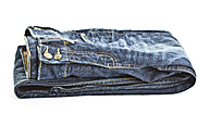 Close up of folded blue jeans on white background - MAEF005014