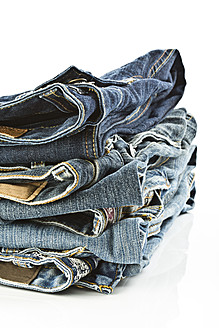 Variety of blue jeans on white background, close up - MAEF005016