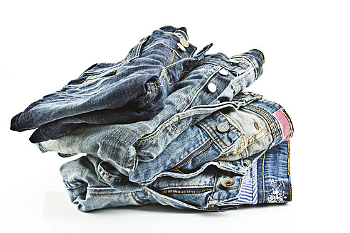 Variety of blue jeans on white background, close up - MAEF005022