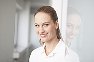 Germany, Dentist smiling, portrait - FMKYF000170