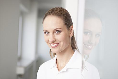 Germany, Dentist smiling, portrait - FMKYF000170