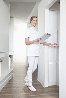 Germany, Dentist opening door - FMKYF000182