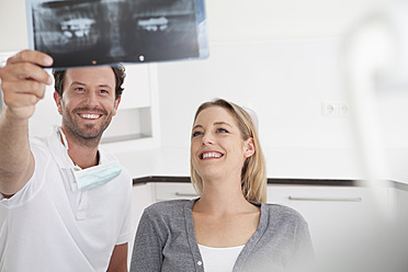 Germany, Dentist and patient viewing x ray - FMKYF000209