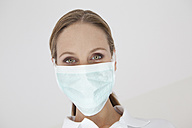 Germany, Close up of dentist with surgical mask - FMKYF000215