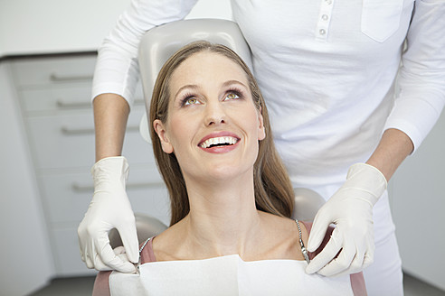 Germany, Patient and dentist in dental office - FMKYF000230