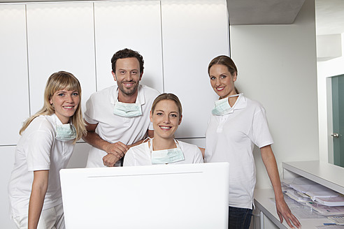 Germany, Dentist and assistance smiling, portrait - FMKYF000245