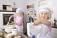 Germany, Girls making dough in kitchem - FKF000084